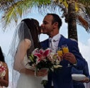bride and groom kissing, orange juice toast, palladium colonial riviera maya