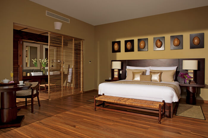 The junior suite tropical view room with a king bed at Zoetry Agua Punta Cana