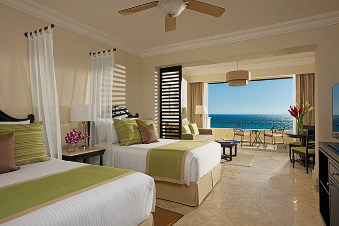 junior suite with two double beds at the Dreams Los Cabos hotel