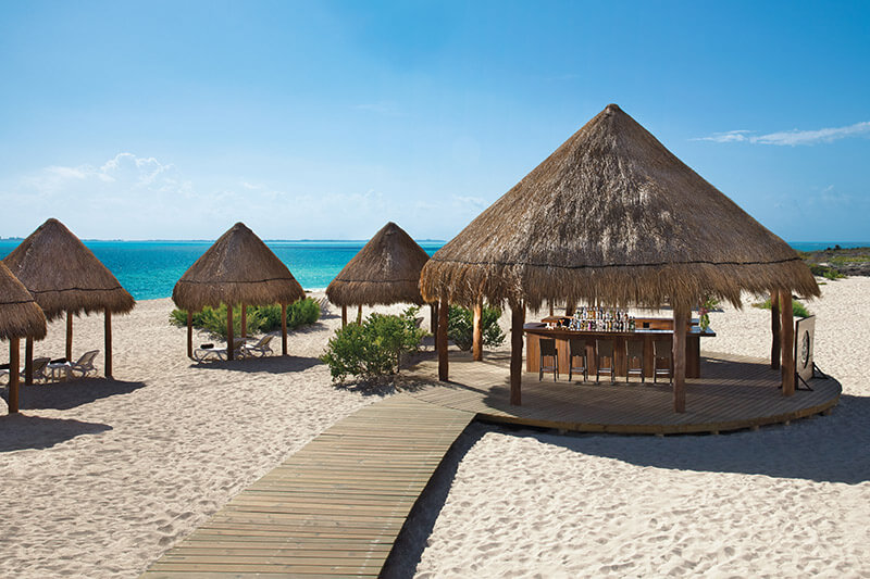 beach area with a palapa bar at Dreams Playa Mujeres