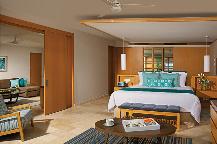 master suite bedroom area with king bed at the Dreams Playa Mujeres