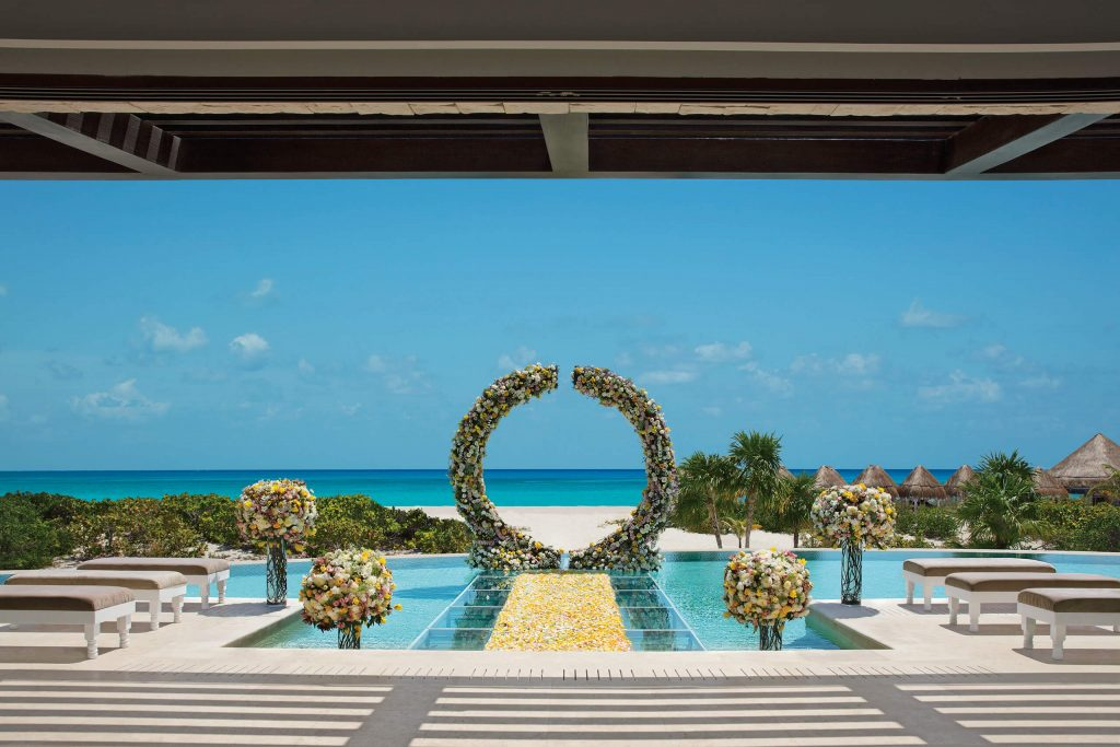 over the pool wedding ceremony, presidential suite at the dreams playa mujeres destination wedding location in mexico