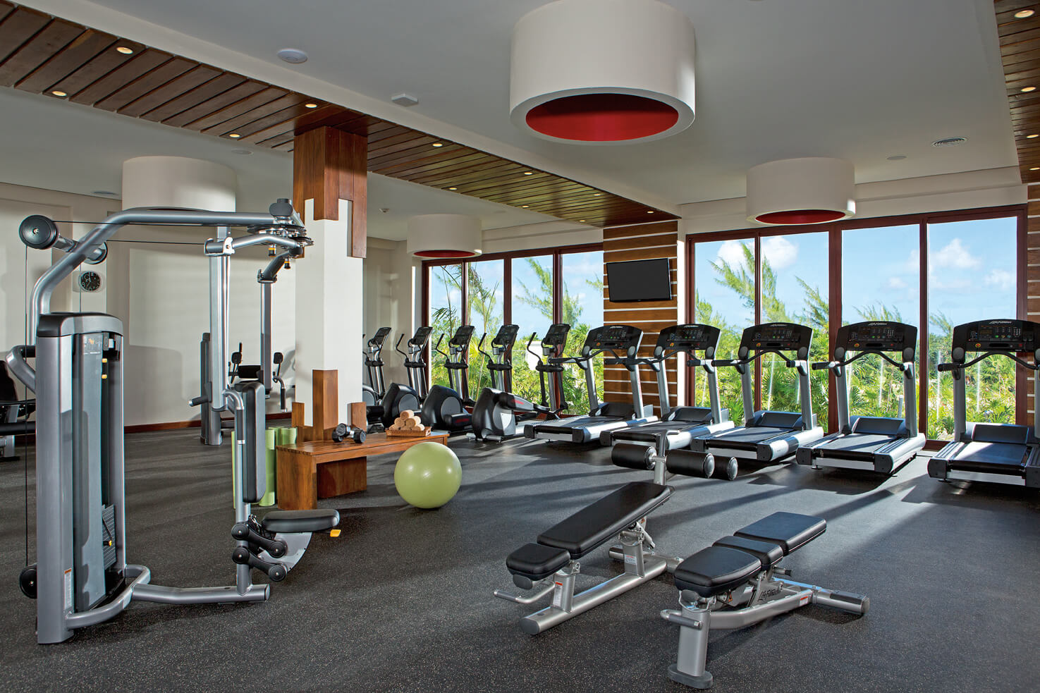 gym area with treadmills and tropical views at the Secrets Playa Mujeres