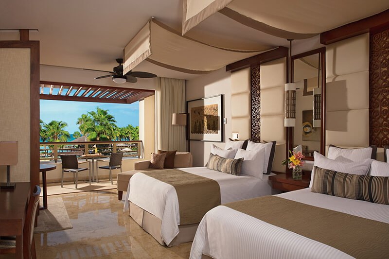 junior suite with two double beds and pool view Secrets Playa Mujeres