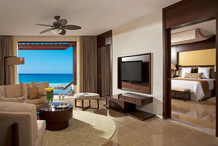 living room area with ocean view swim out area Secrets Playa Mujeres
