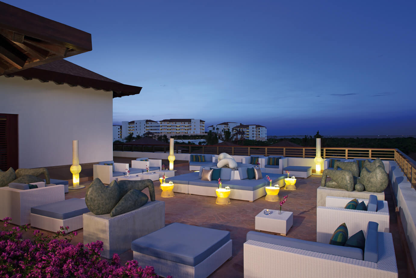 outdoor rooftop terrace area at the desires lounge bar Secrets Playa Mujeres