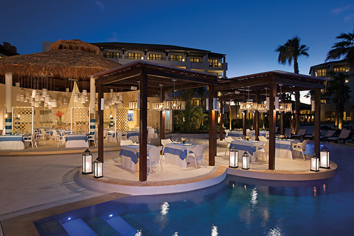 Seaside grill restaurant by the pool at the Secrets Playa Mujeres