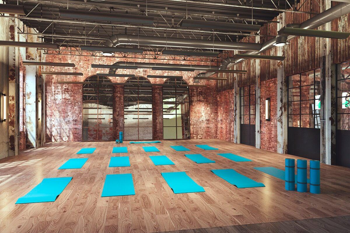 yoga mats on a hard wood floor inside the gym at hyatt ziva cap cana