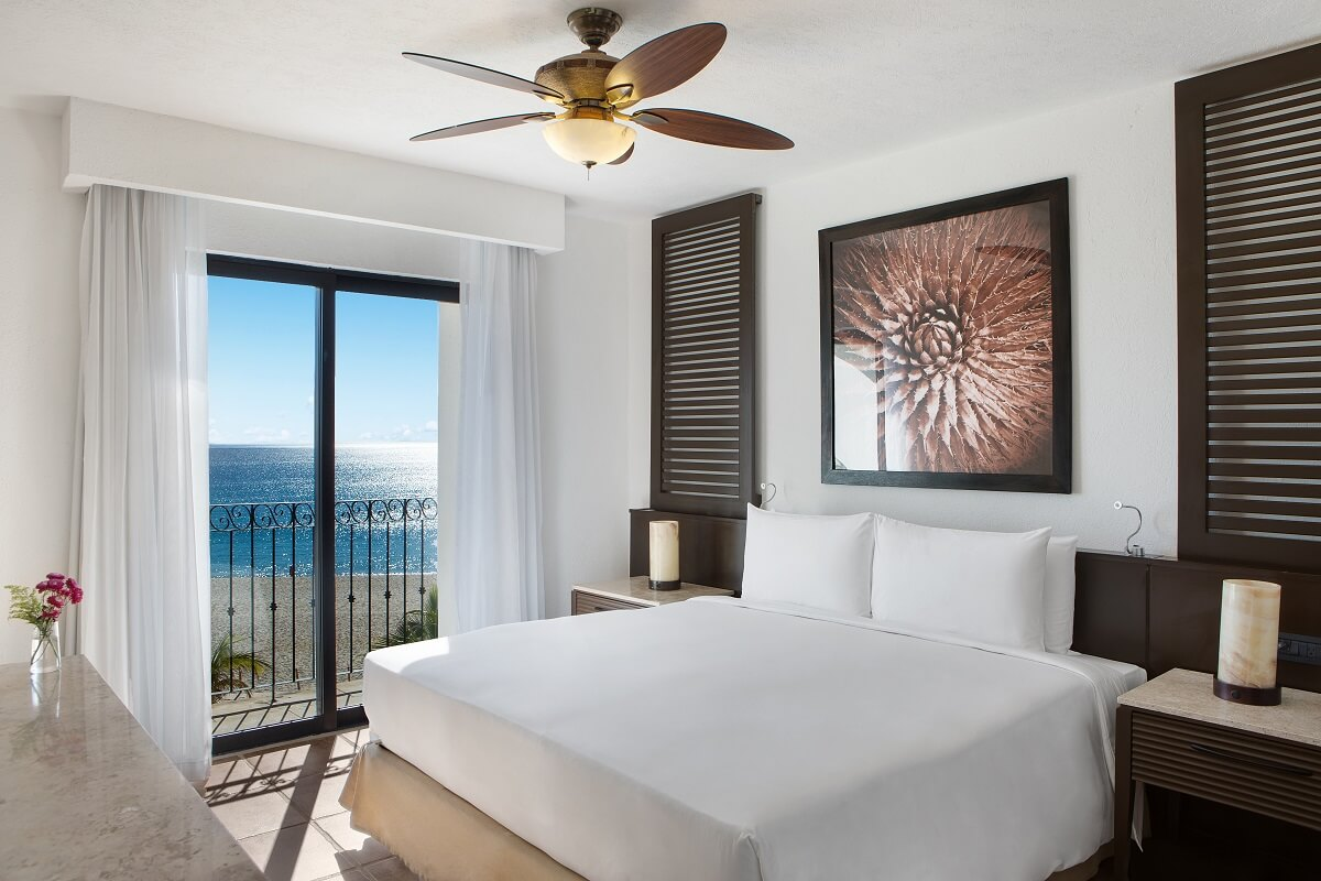 room with a king bed and ocean view at Hyatt Los Cabos