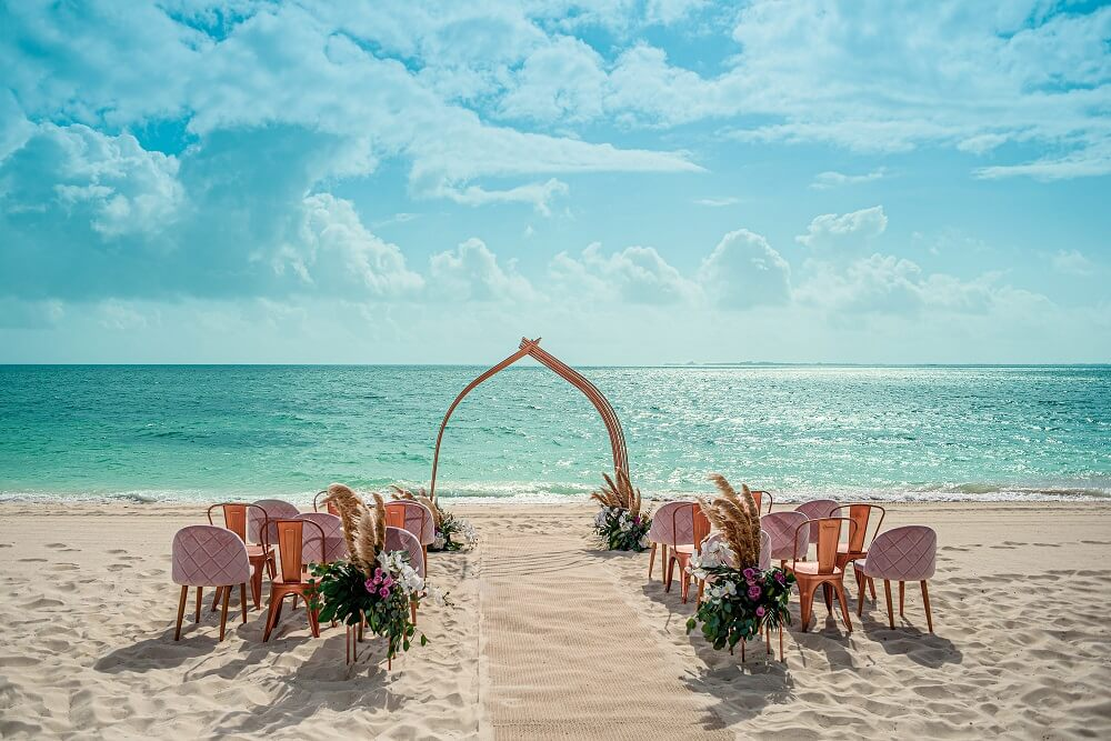 elegant beachfront wedding ceremony at atelier hotel playa mujeres