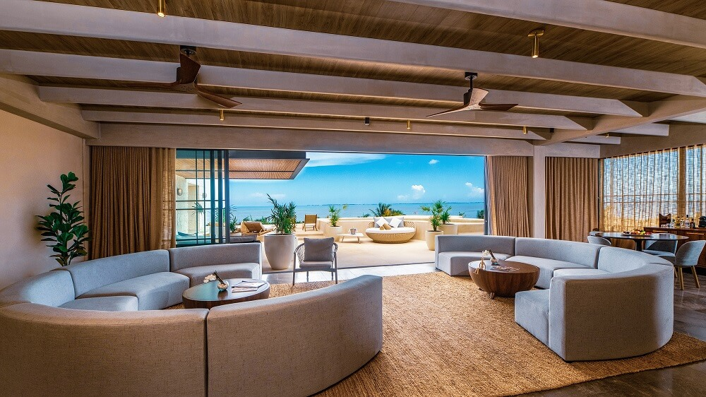 living room area and views of the master suite terrace at atelier playa mujeres
