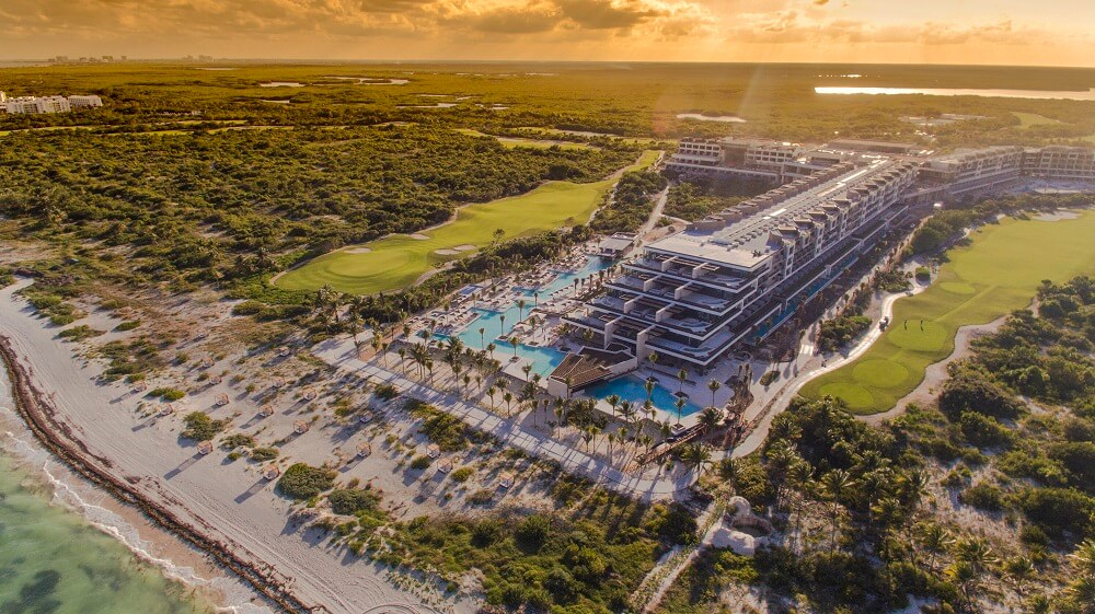 aerial picture of atelier hotel and playa mujeres golf club in playa mujeres