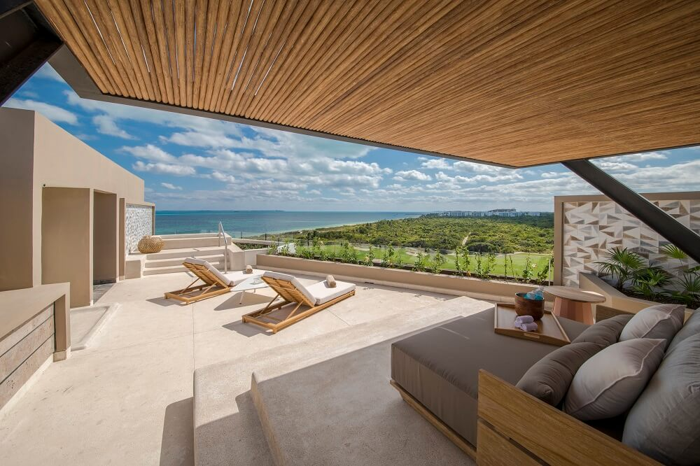 ample rooftop terrace with loungers, plunge pool and ocean views atelier playa mujeres