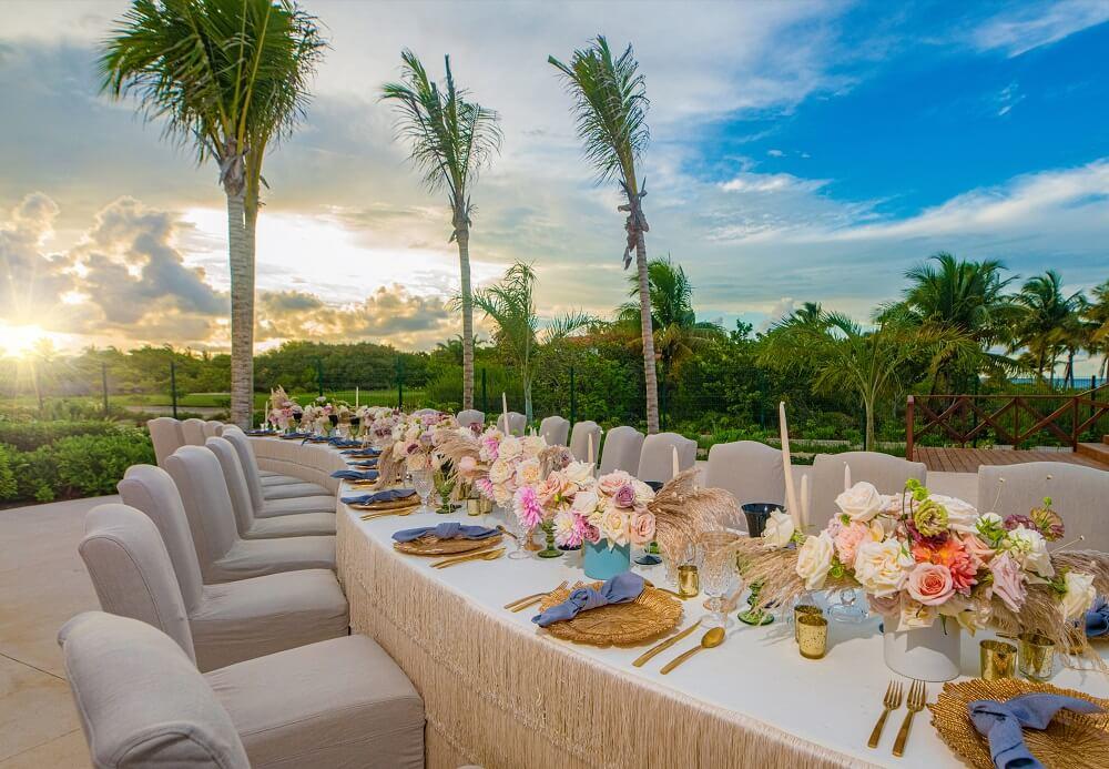 garden wedding reception set up at sunset atelier playa mujeres