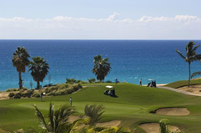 view of the golf course and ocean at the paradisus los cabos golf course