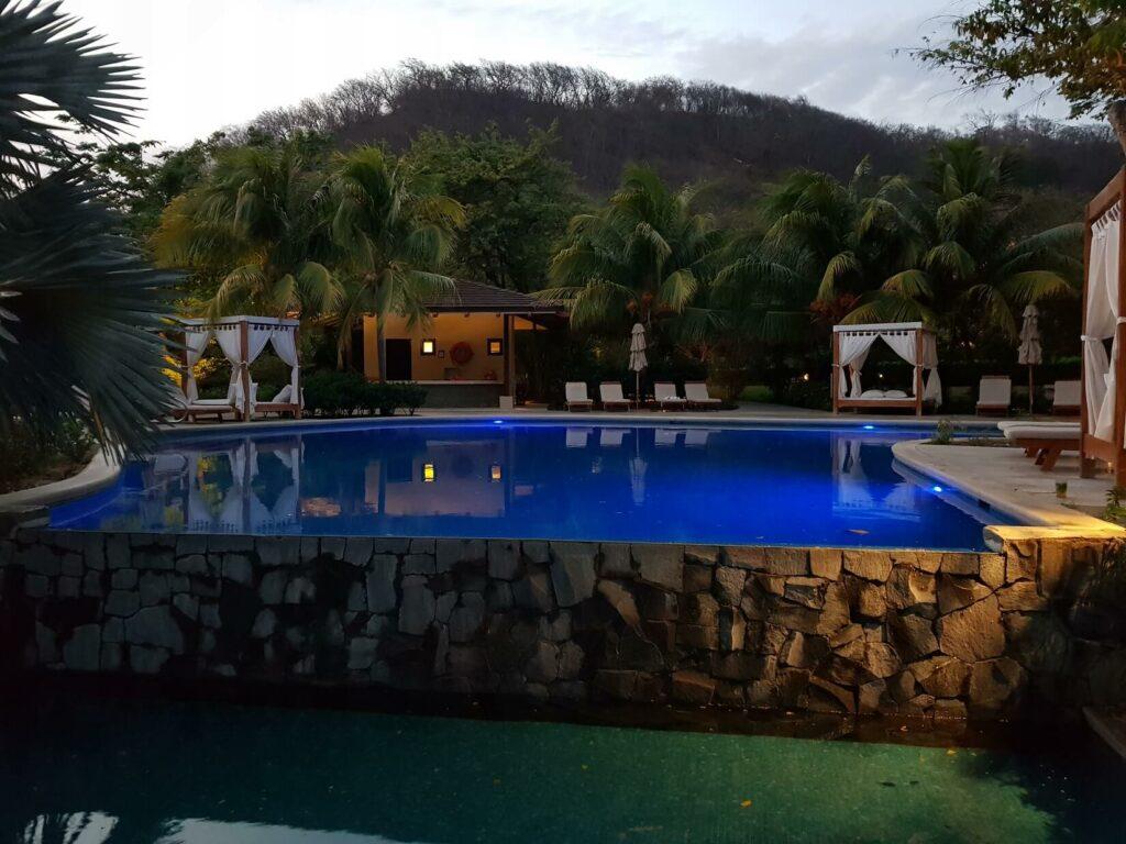 pool area at dusk at dreams las mareas