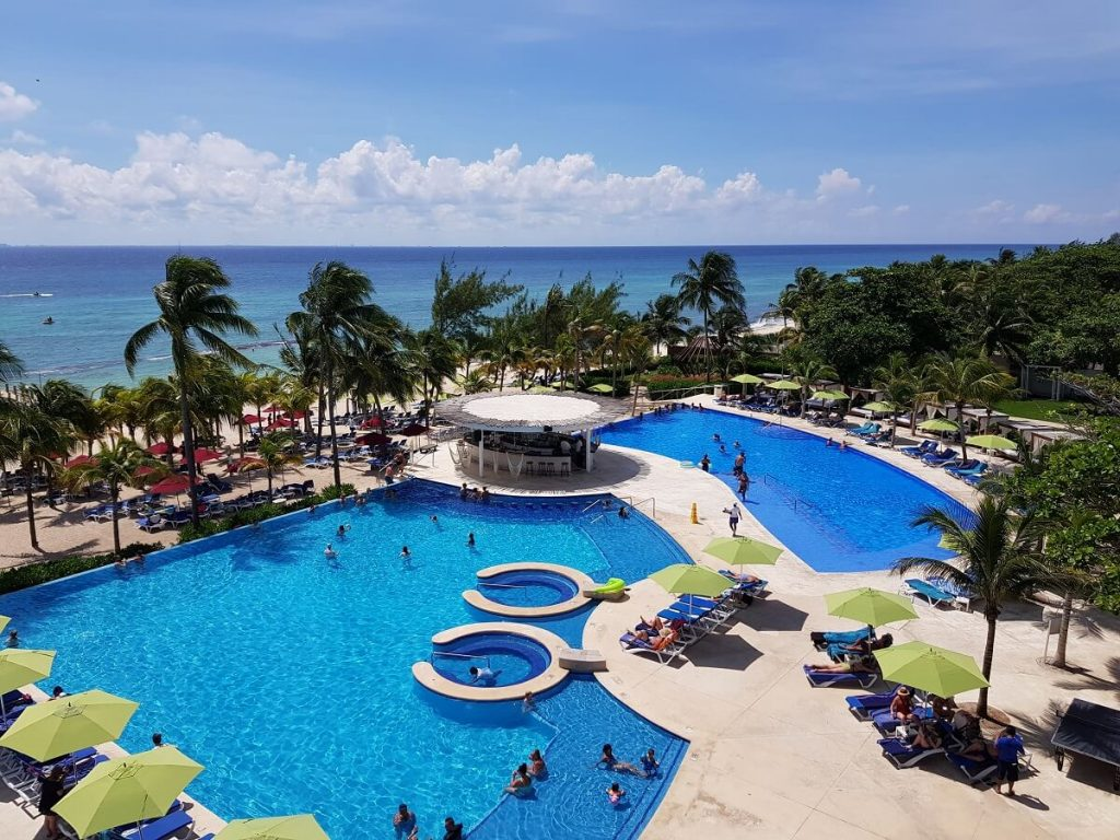 aerial view of the main pool and swim up bar at the fives beach hotel