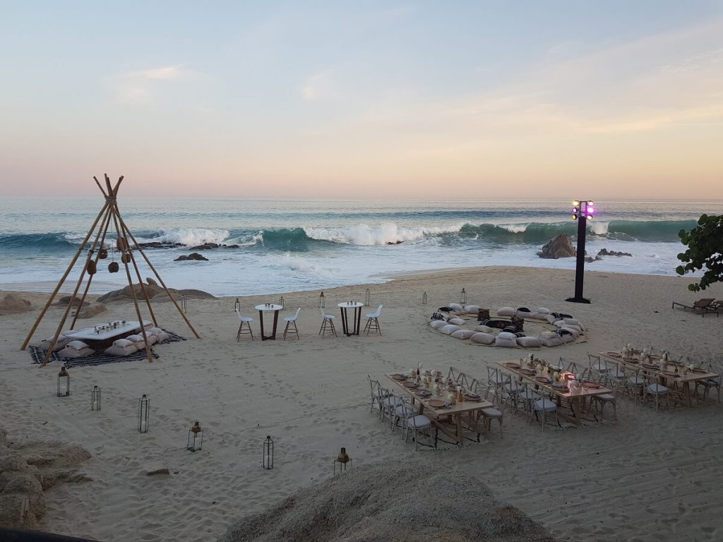beach wedding set up for a large wedding group at the grand velas los cabos