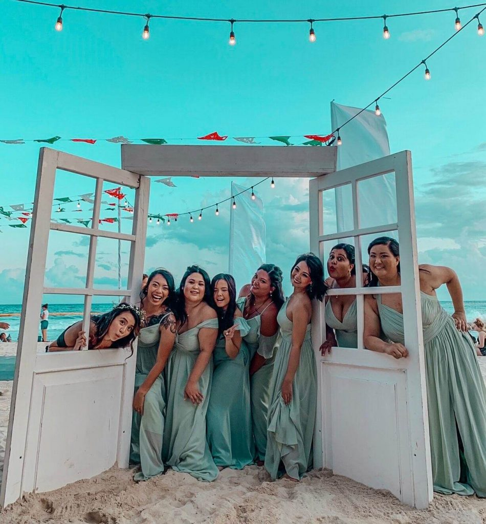 bridal party with mint green dresses on the beach