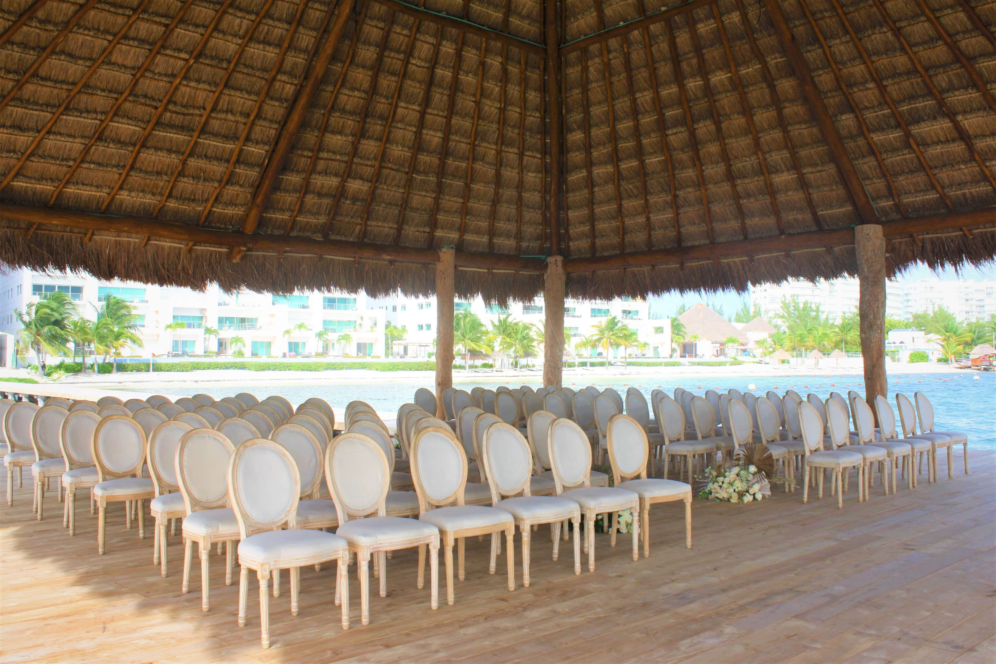 wedding ceremony set up on the pier at dreams vista cancun