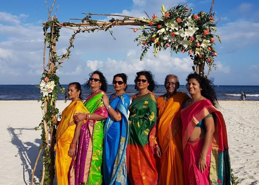 colorful saris on the beach destination wedding