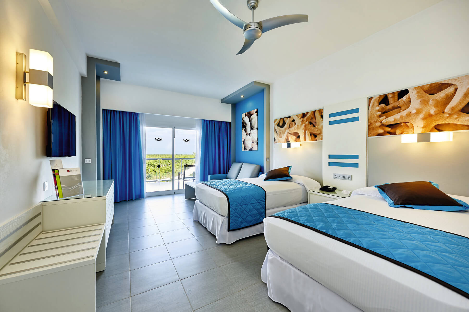 standard room with two double beds at hotel riu dunamar in costa mujeres