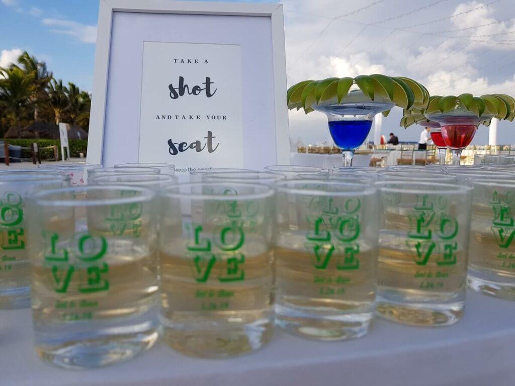 love shot glasses at a destination wedding.
