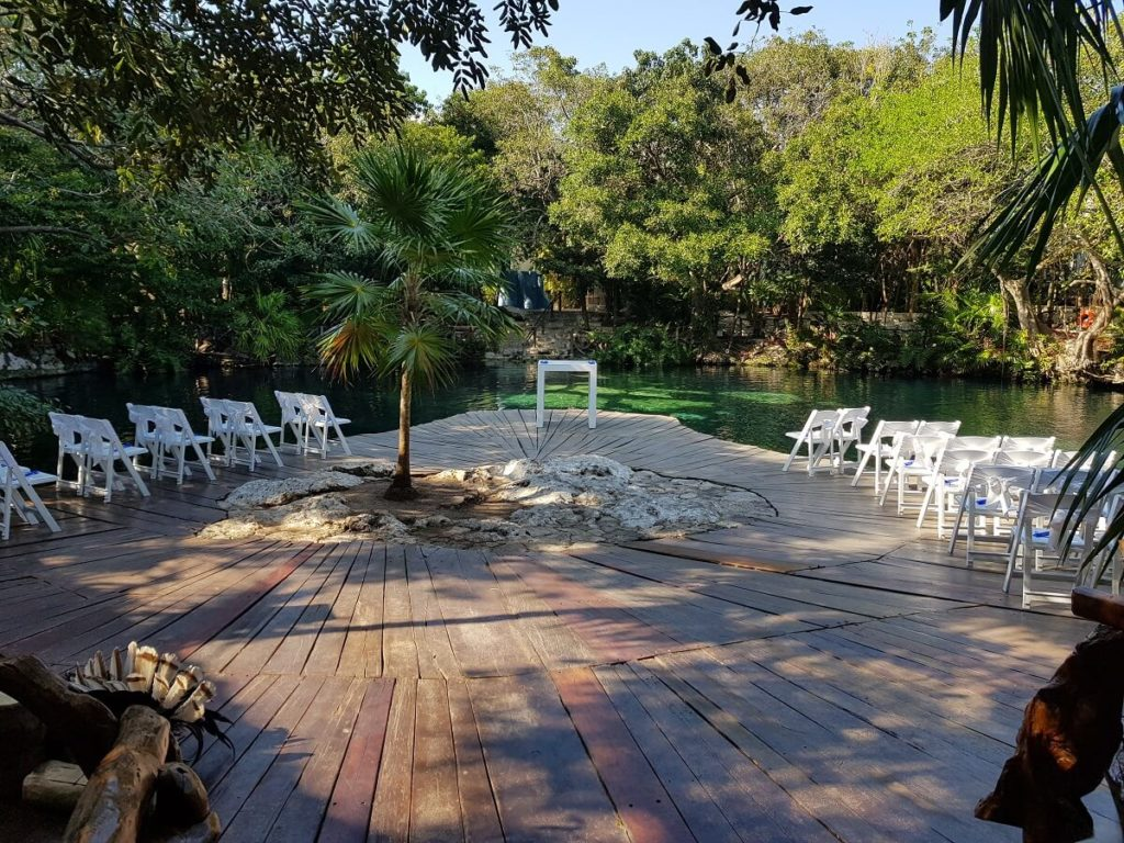 basic white decor set up at the cenote for weddings at sandos caracol