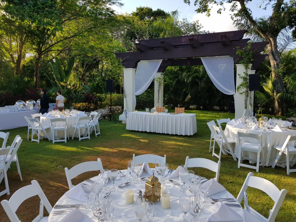 garden venue with white wedding set up sandos playacar weddings