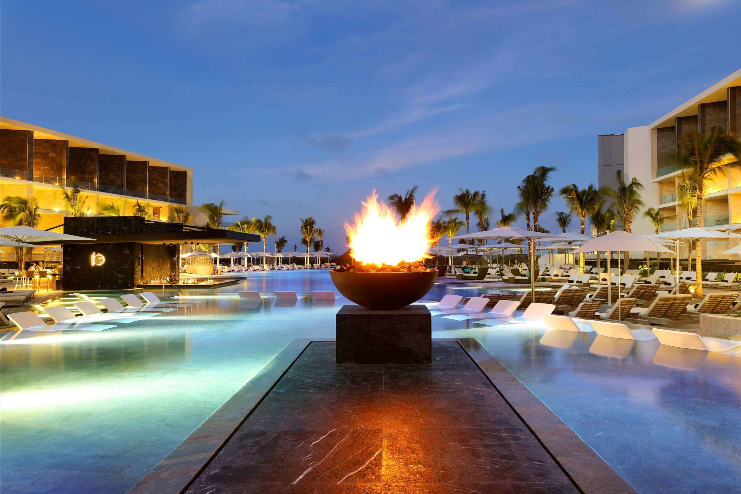 pool with firepit at dusk