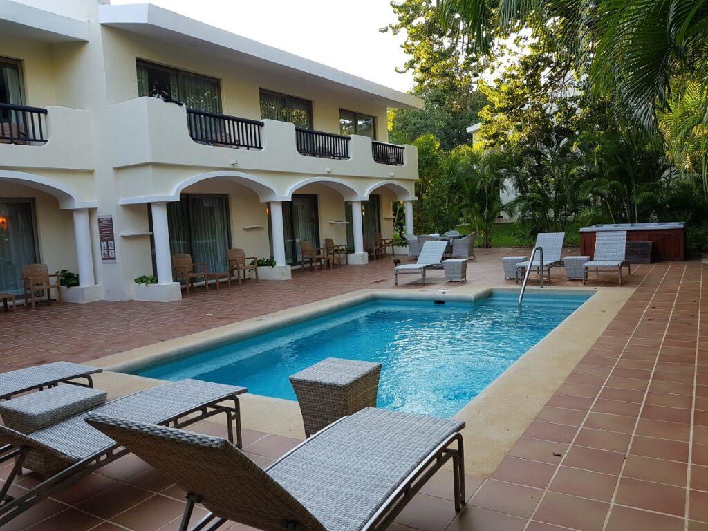 hacienda junior suite outdoor area with pool