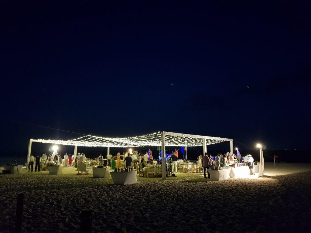 beach wedding reception with string lights on sandos playacar beach