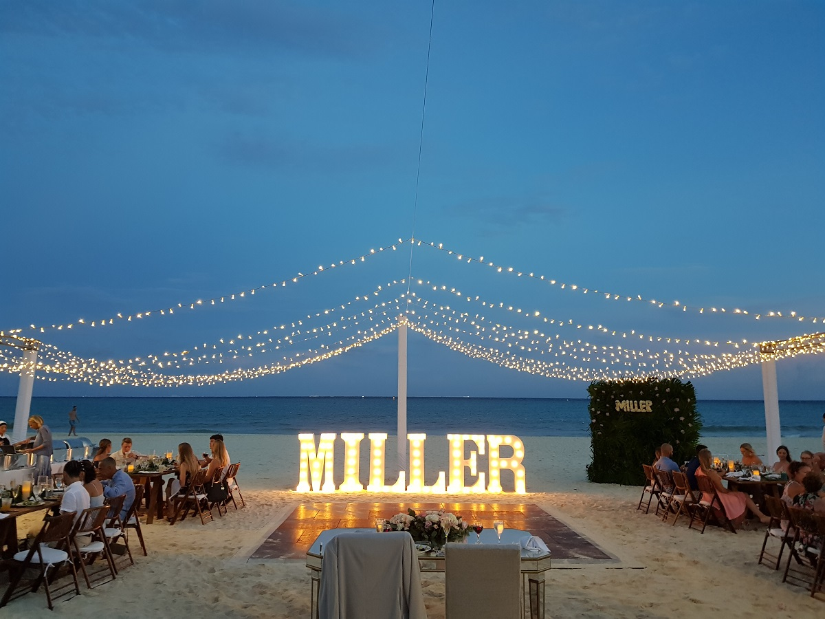 real sandos weddings, a reception with string lights on the beach