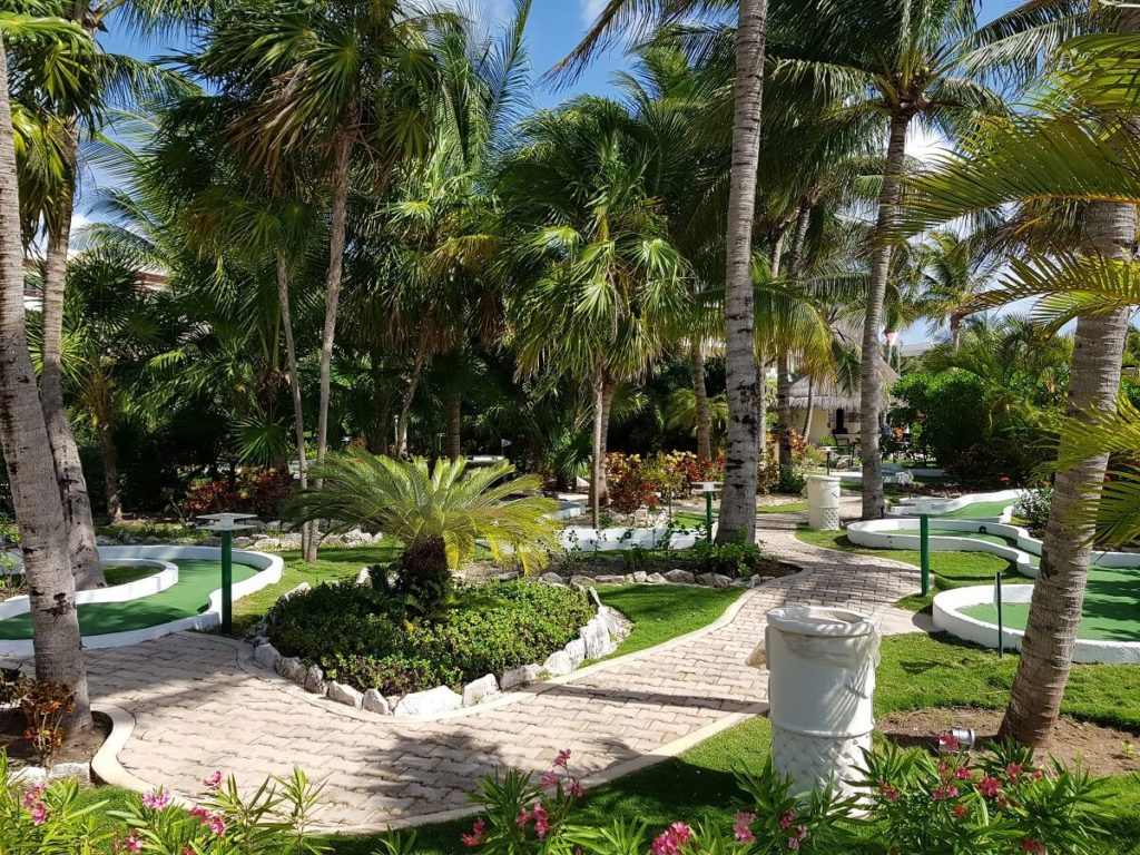 garden area with mini golf at the secrets maroma