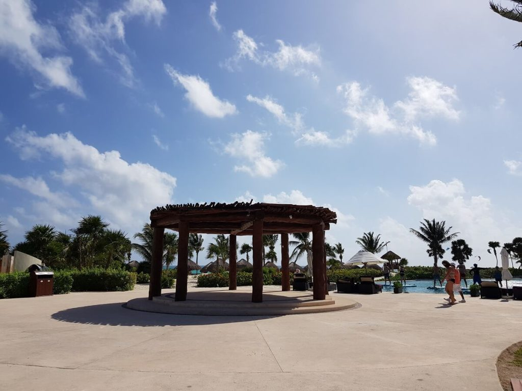 the poolside wedding gazebo and terrace area at the secrets maroma