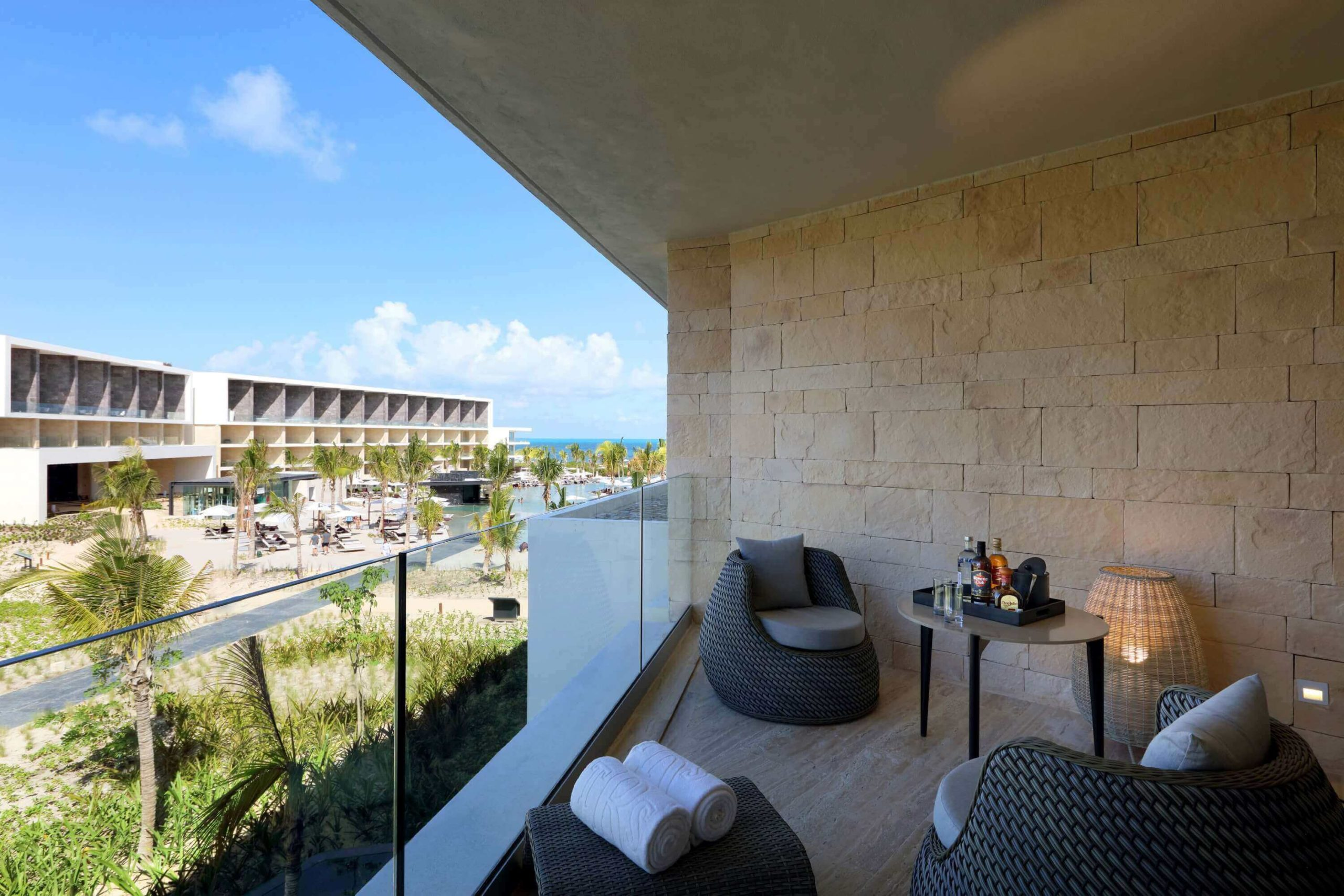 balcony area with partial ocean view of the junior suite trs coral