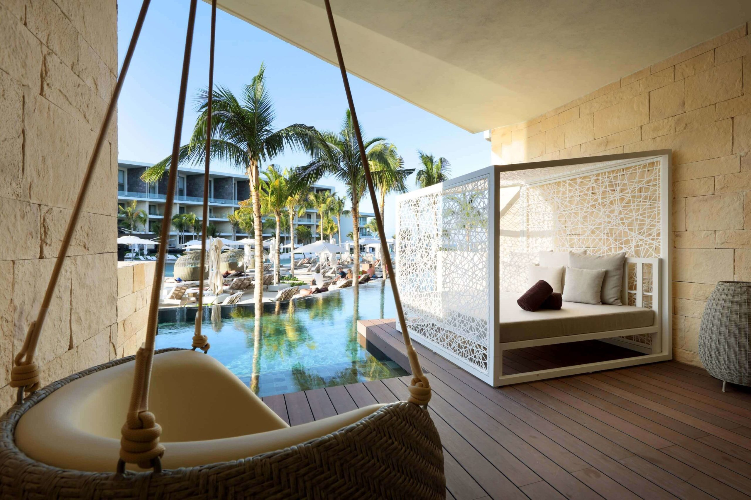 terrace with bali bed and swim out area junior suite TRS Coral Costa Mujeres