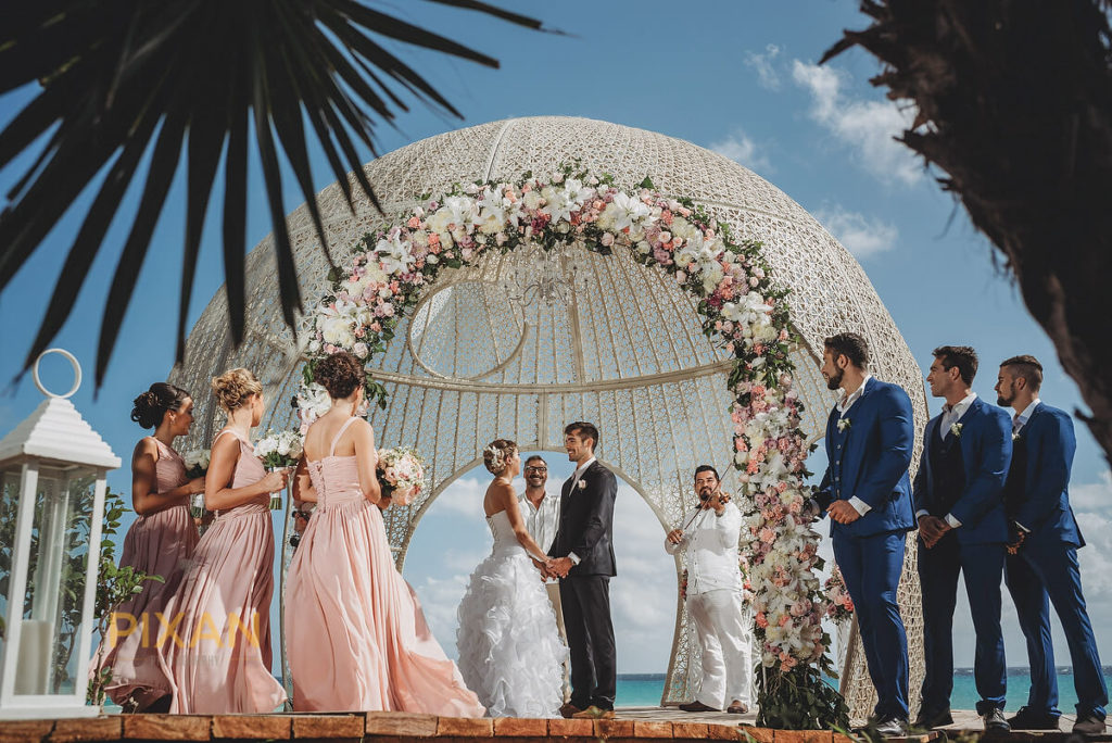 wedding ceremony in a dome like wedding gazebo