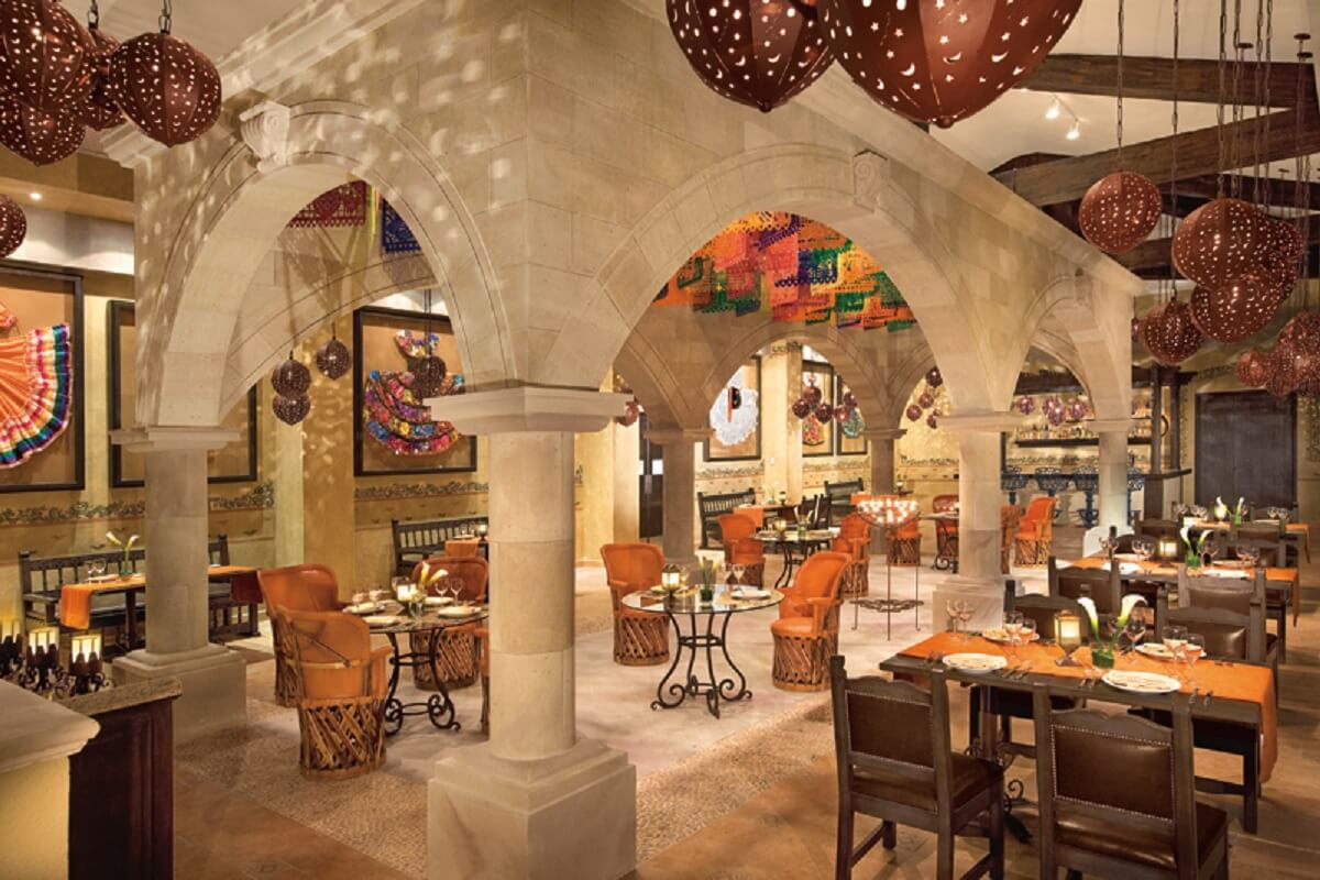 mexican restaurant with tradicional mexican dresses as decor