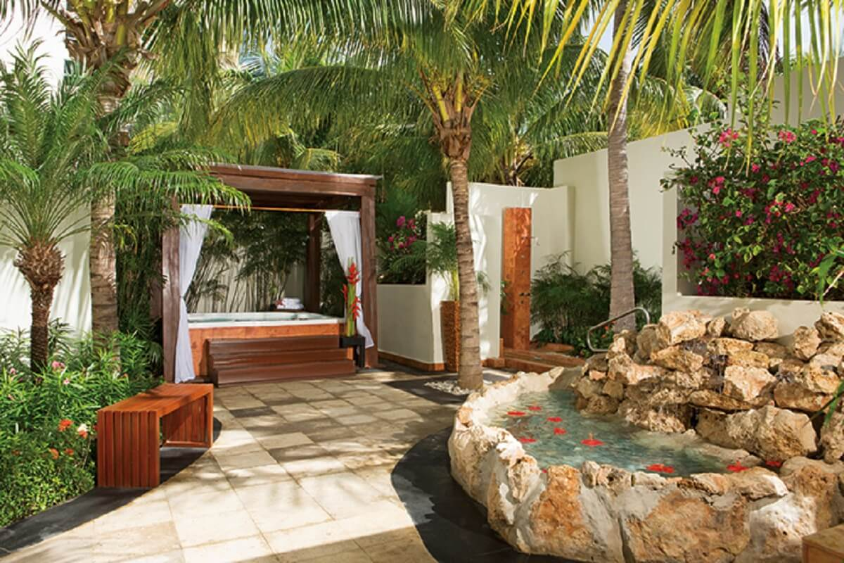 outside spa terrace with surrounding palm trees