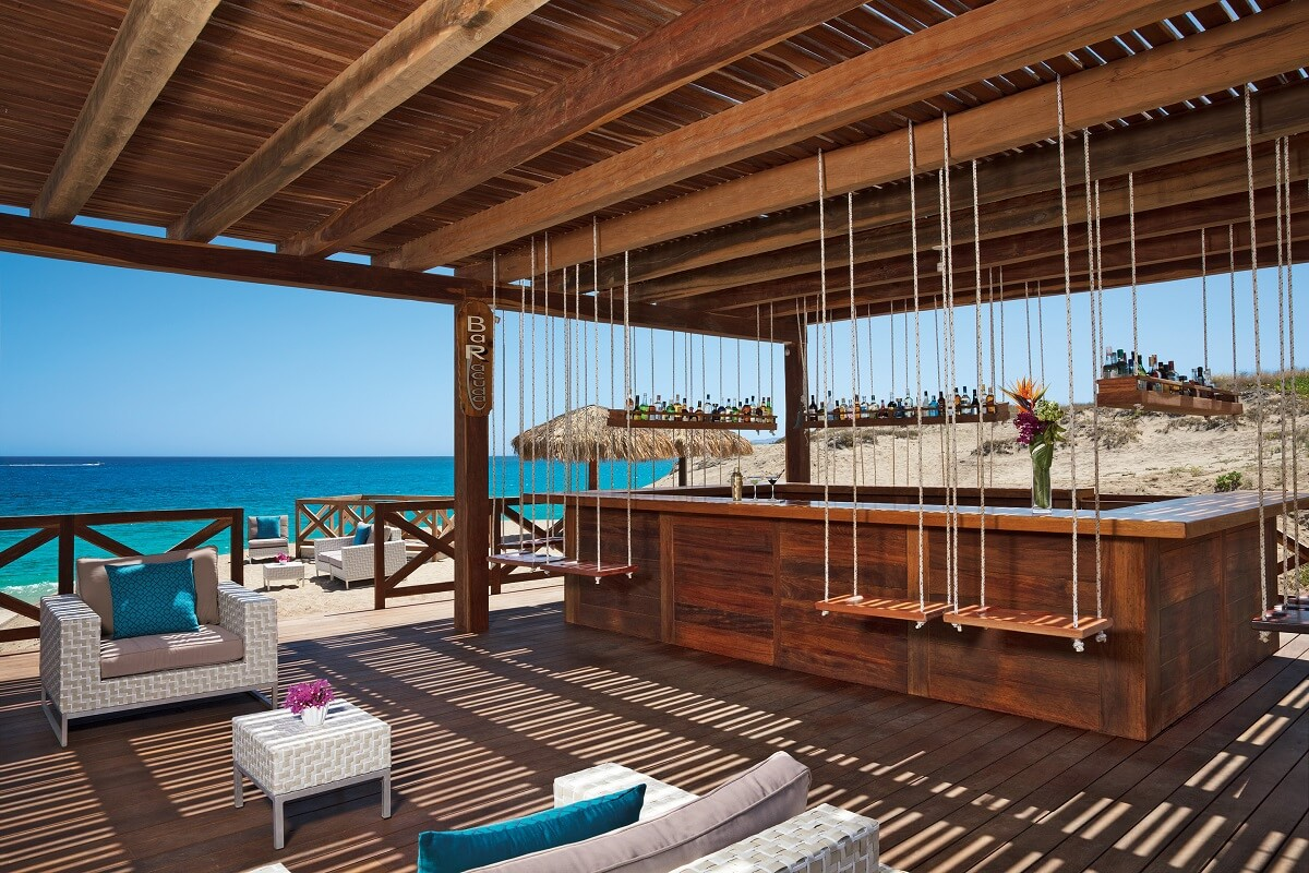 wooden bar area with swings and ocean view