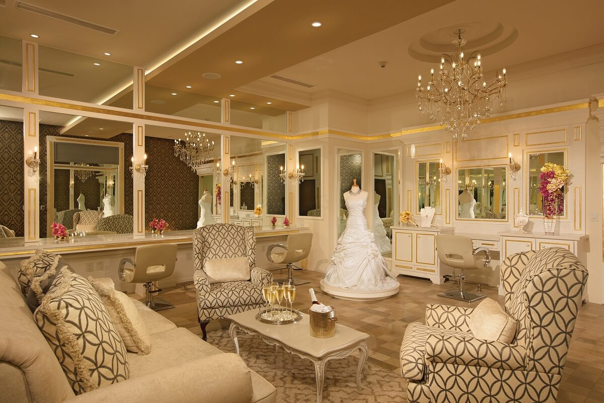 bridal suite interior with multiple mirrors and plush furniture