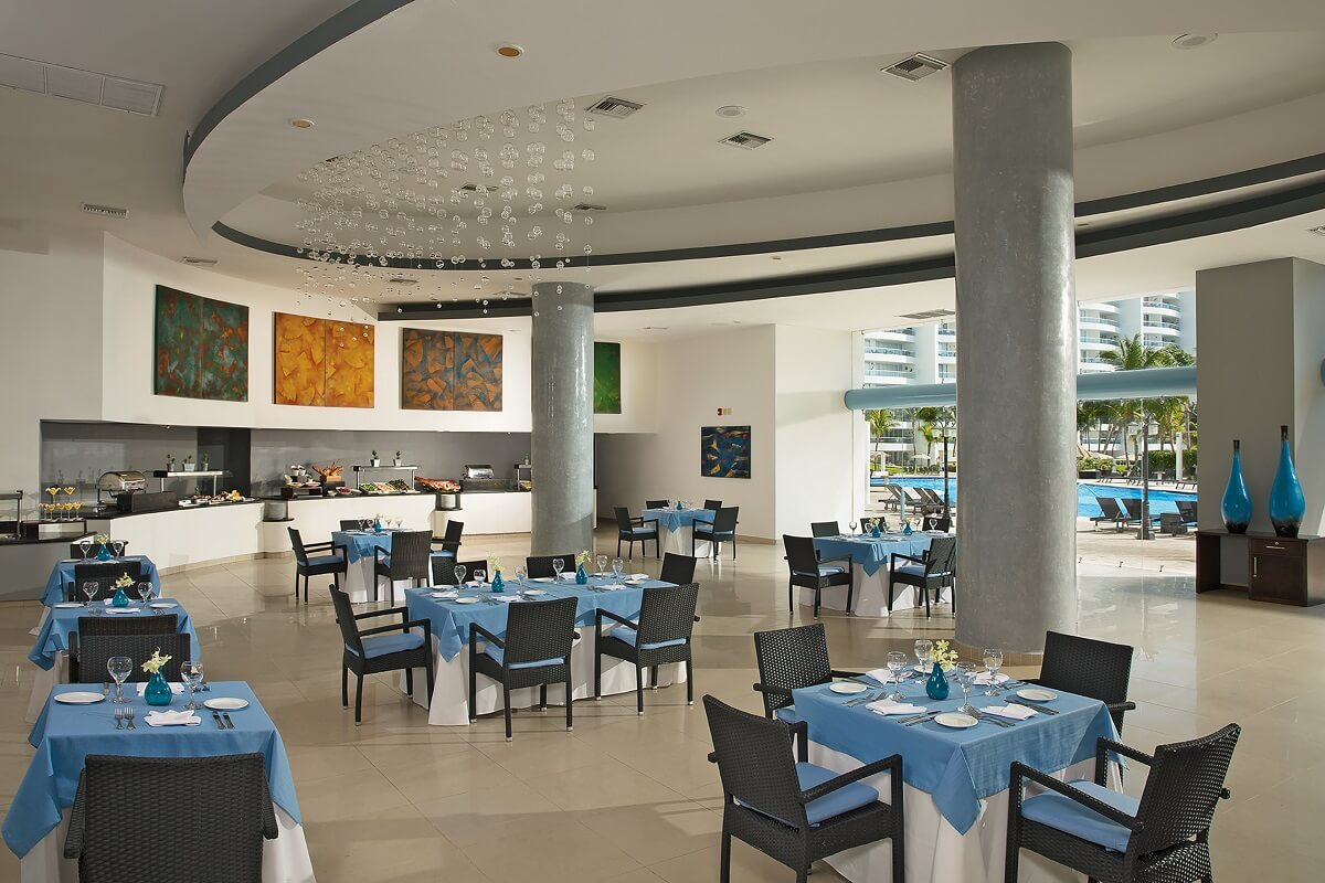 buffet restaurant interior with blue table clothes and pool view