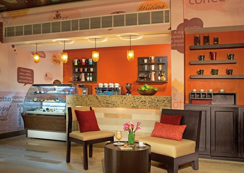 cafe interior with order counter and sweet display