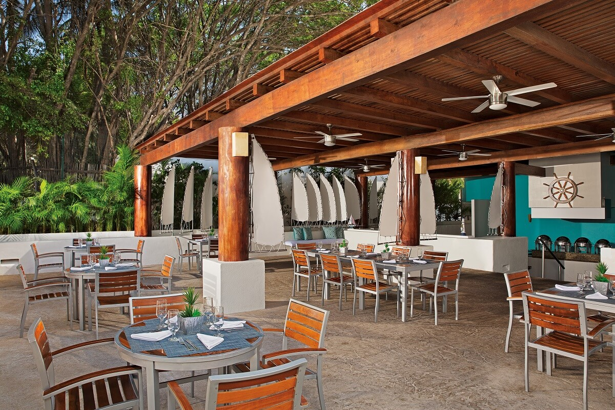 outdoor restaurant with wooden chairs