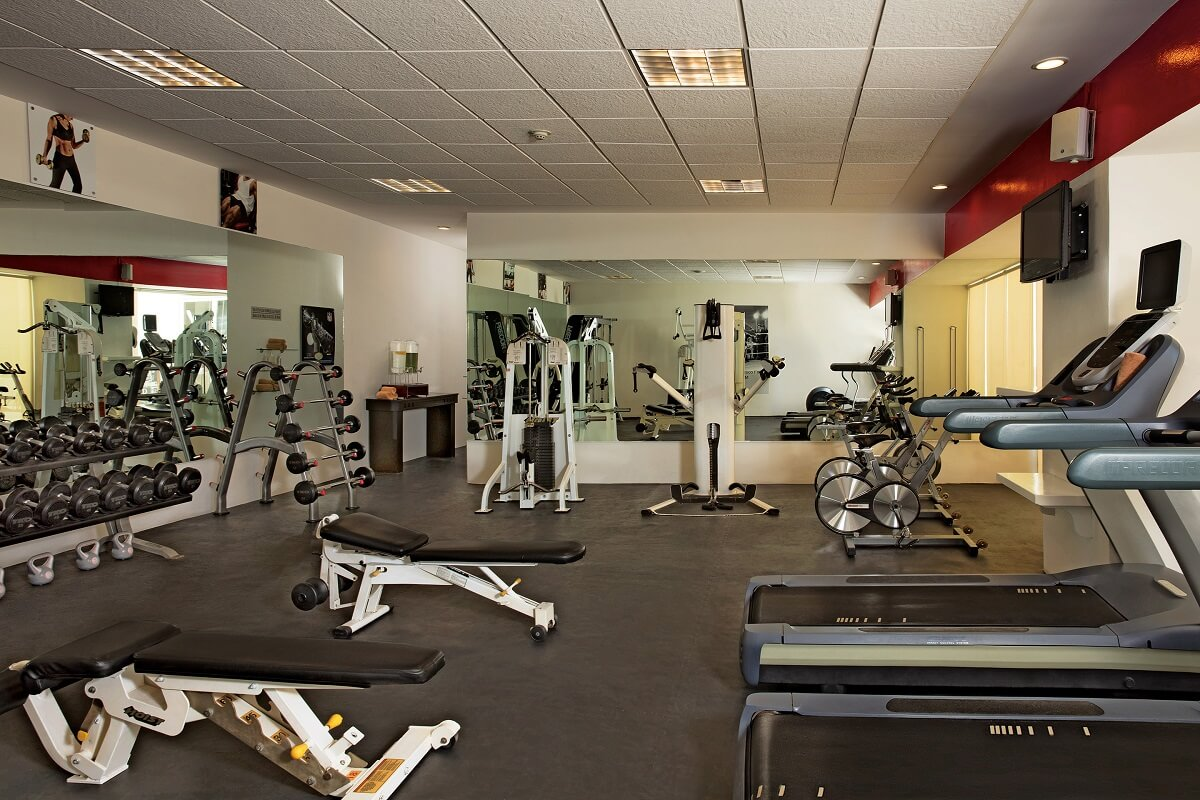 interior of fitness center with free weights and cardio machines