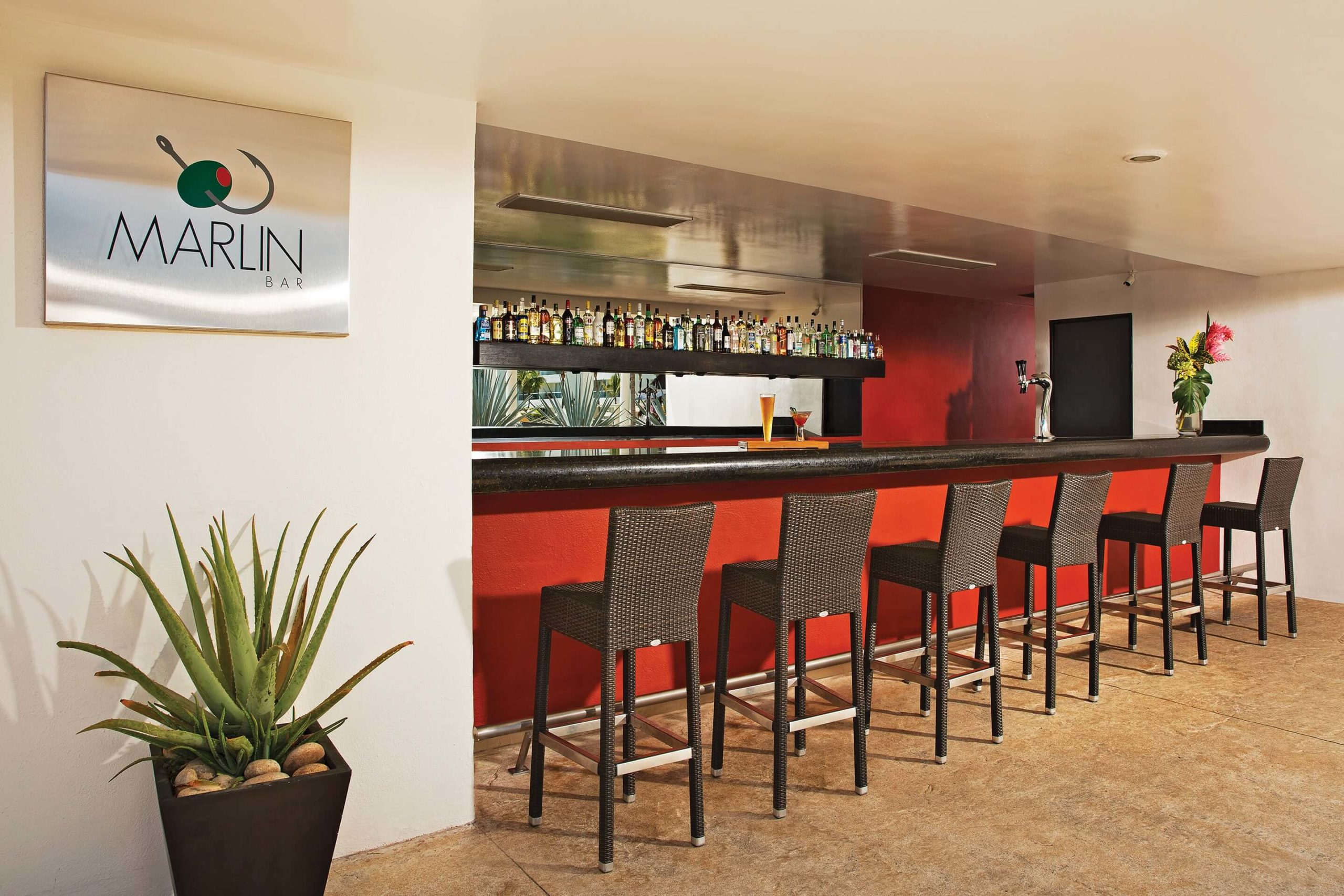 wooden bar with 6 high wicker stools