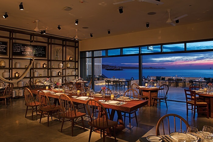 restaurant with wall to wall windows overlooking the water at the breathless los cabos