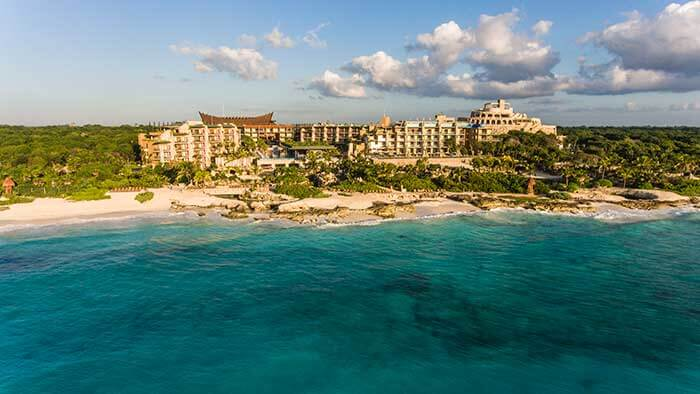 aerial view of beach and buildings from the ocean at hotel xcaret