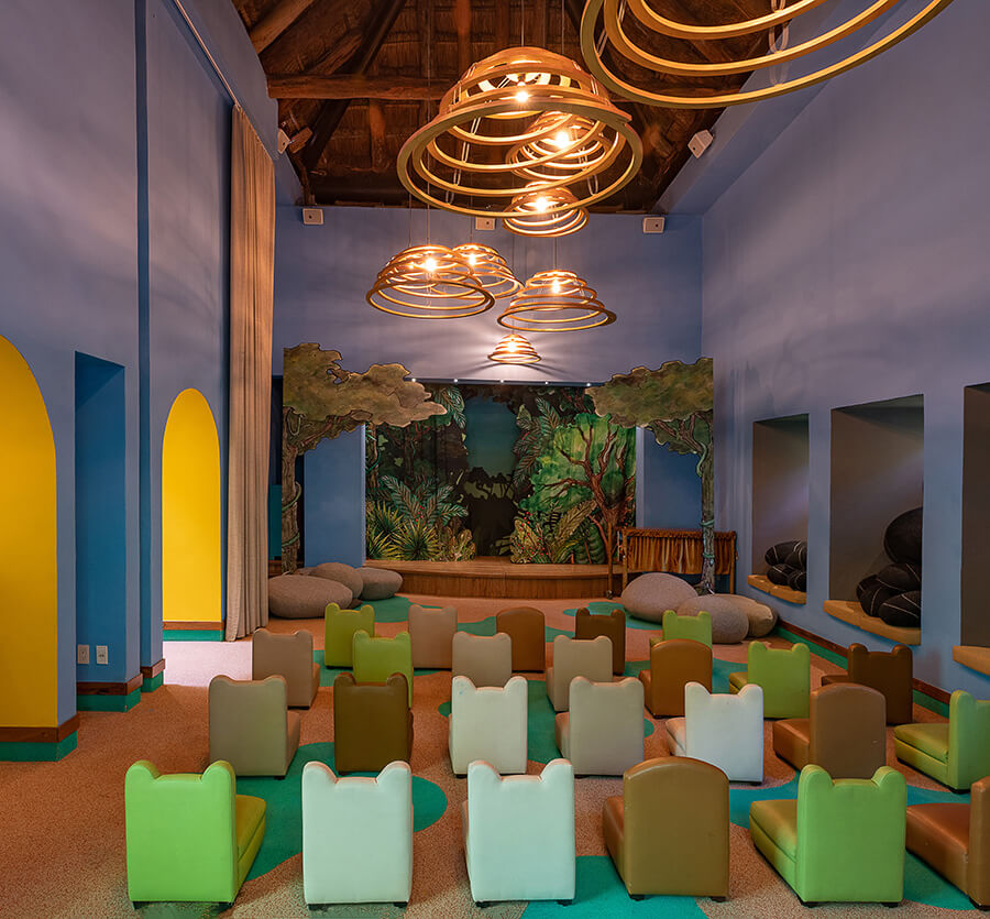 interior of the kids club with mini-chairs and a theater area hotel xcaret